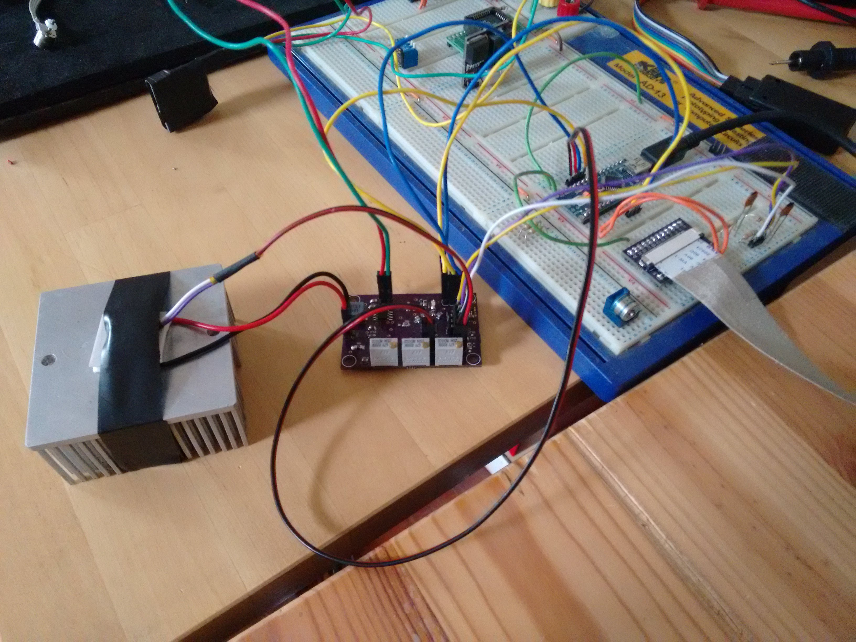 project logs bull ic tec controller bull io test setup tec thermistor and heat sink plus connections to arduino for control and monitoring of current and voltage signals