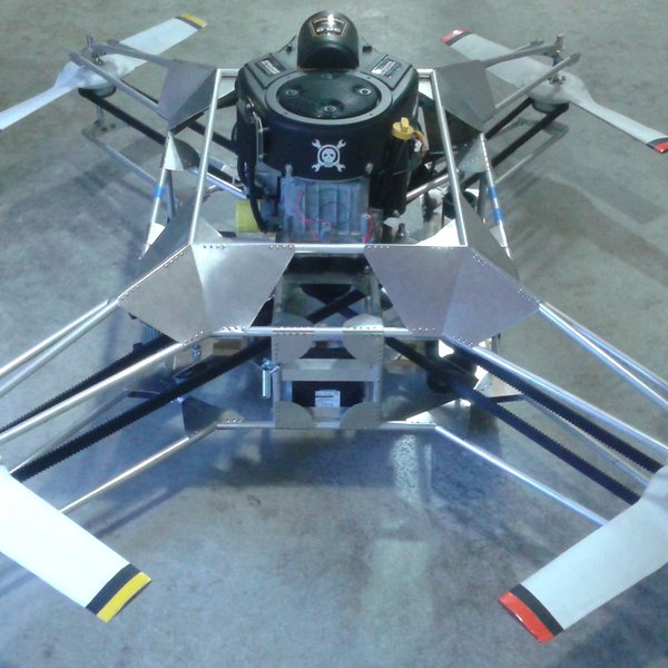 The Goliath quadcopter was designed for and entered in the Hackaday Prize Competition. It is created with a single gasoline engine that delivers about 30 horse powers. The engine controls the propellers via control cables attached to it, eliminating the need for rotors.